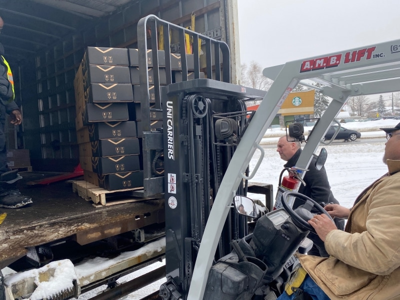 Unloading a shipment of lights