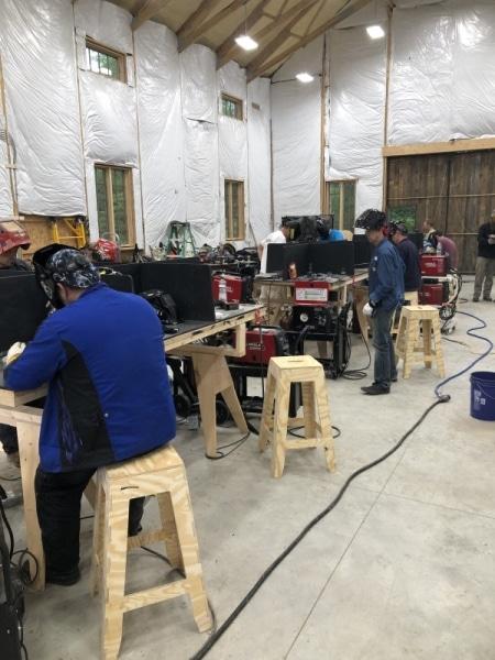 Everyone hard at work welding